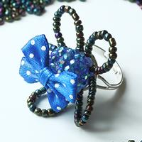 Instruction on Making Charm Flower Rings With Seed Beads and Blue Bow