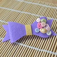 A Simple Method of Making Flat Purple Felt Hair Bows with Buttons