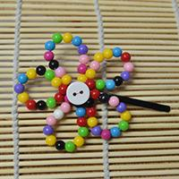 Easy Instructions on Making a Rainbow Beaded Flower Hair Clip