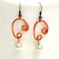 Step-by-step Guide on Making Homemade Sweetheart Earrings with Wire and Pearl