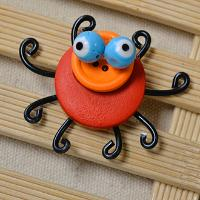 How to Make an Orange Colored Spider with Black Legs for Halloween
