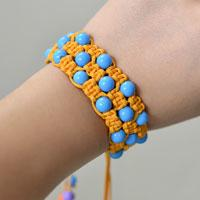How to Make an Orange Square Knot Friendship Bracelet with Blue Acrylic Beads