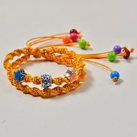 How to Braid a Yellow Cord Friendship Bracelet with Colorful Acrylic Beads