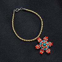 How to Make a Leather Cord and Two-Hole Seed Bead Flower Bracelet