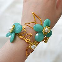 How to Make a Personalized Gold Wire Wrapped Bracelet with Blue Stone Flower Decorated