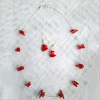 Coral necklace and earring sets sparkle, rain or shine