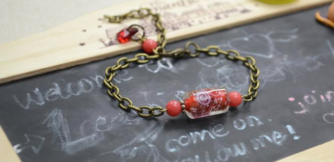 Make a chain bracelet with lampwork bead and glass heart pendant