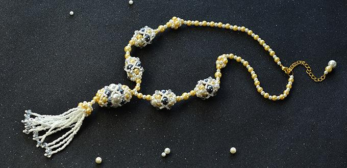 Detailed Pandahall Tutorial on How to Make a Pearl Bead Ball Necklace with Tassel Pendant