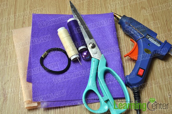materials and tools for making a two-tone orchid flower hair tie