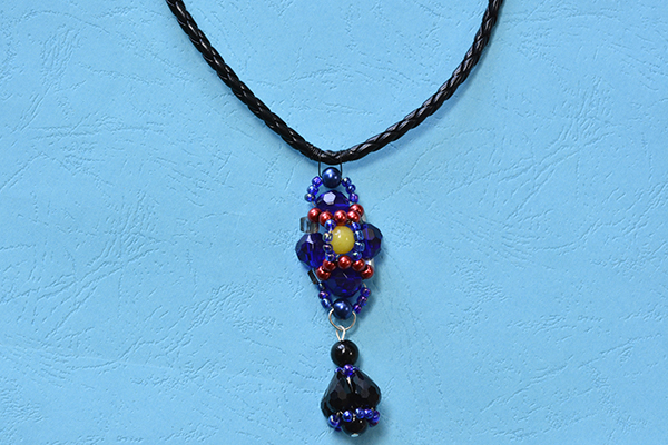 final look of the blue bead pendant necklace with black leather cords
