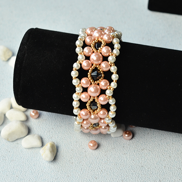 final look of the wide pink and white pearl bead bracelet