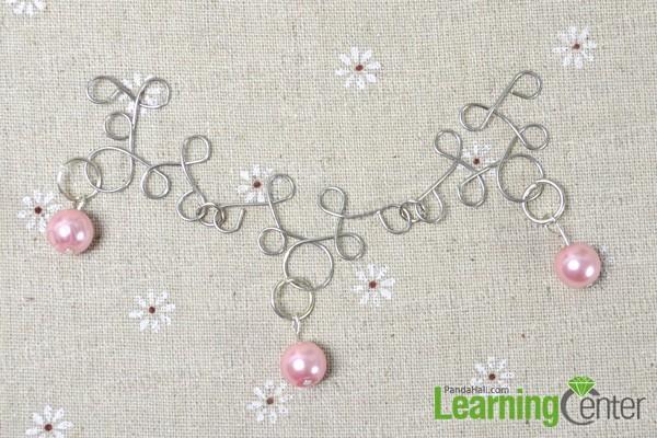 hang bead dangles to the bigger loop
