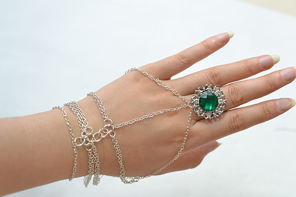 The final look of the silver chain linked bracelet with rhinestone ring is displayed here!