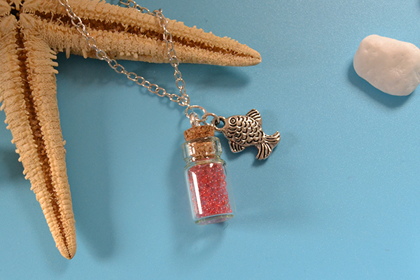 final look of the bottle and fish pendant necklace