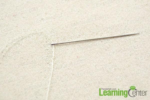 thread the cord through needle