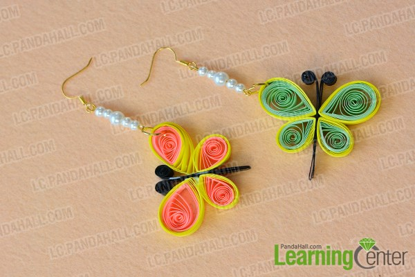 Finish this pair of butterfly dangle earrings