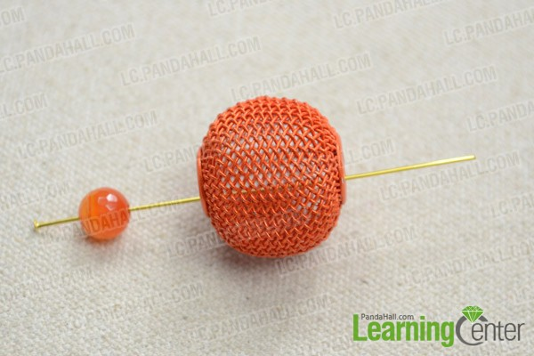 slide glass bead and mesh bead onto head pin