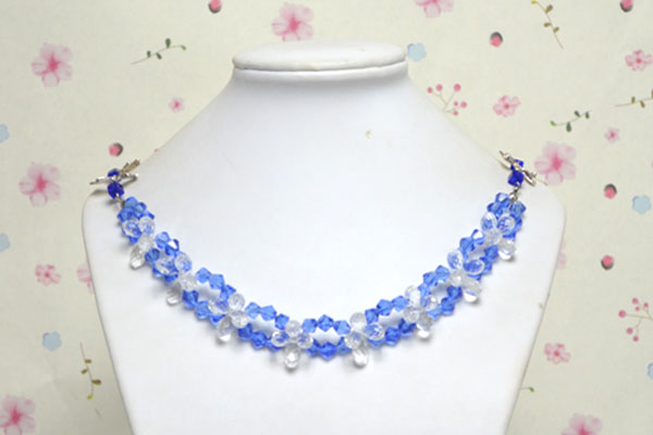 the final look of sapphire lotus flower neclace