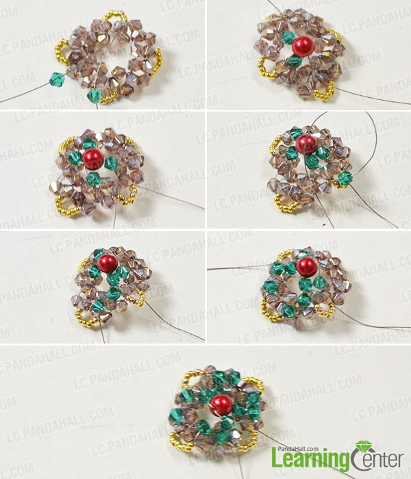 Add green glass bead and red pearl adornments