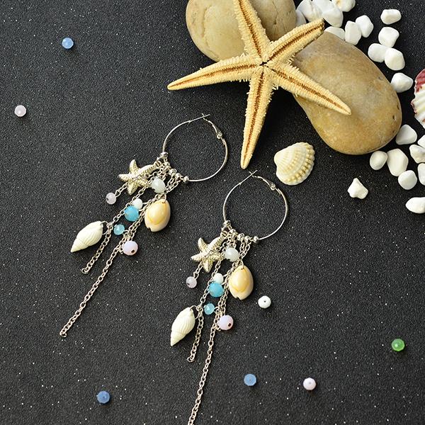 the final look of the chain tassel hoop earrings: