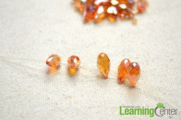 Slide the glass teardrop beads one by one