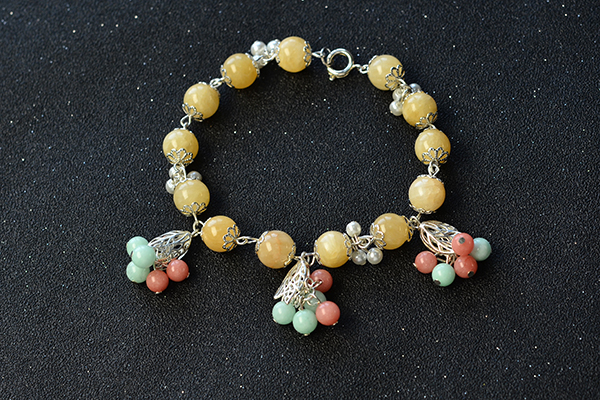 the finished jade bead charm bracelet