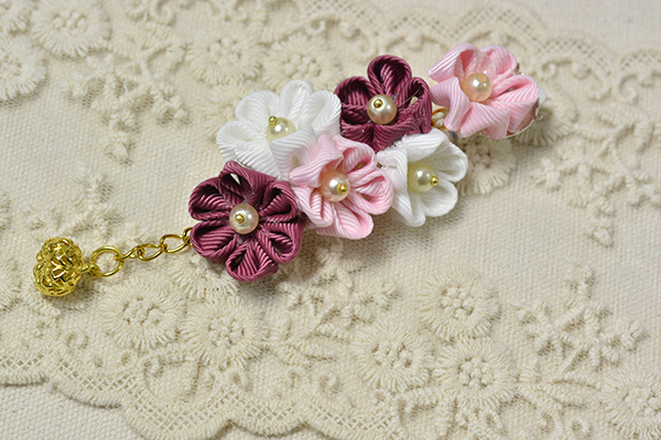final look of one of the handmade ribbon floral drop earrings