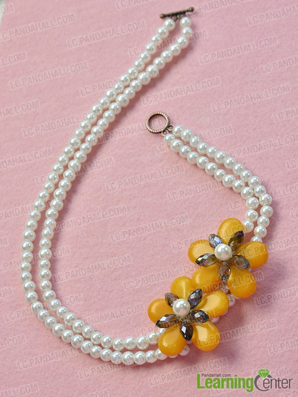 make the rest part of the white two-strand pearl bead necklace