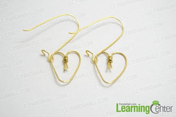 a pair of heat shaped hoop earrings