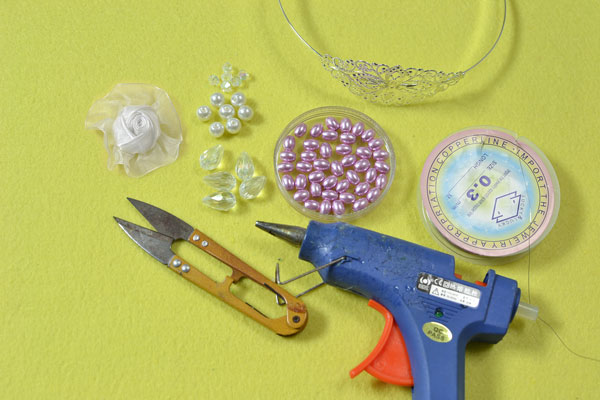 Supplies in making the headband for girl with organza flowers and beads: