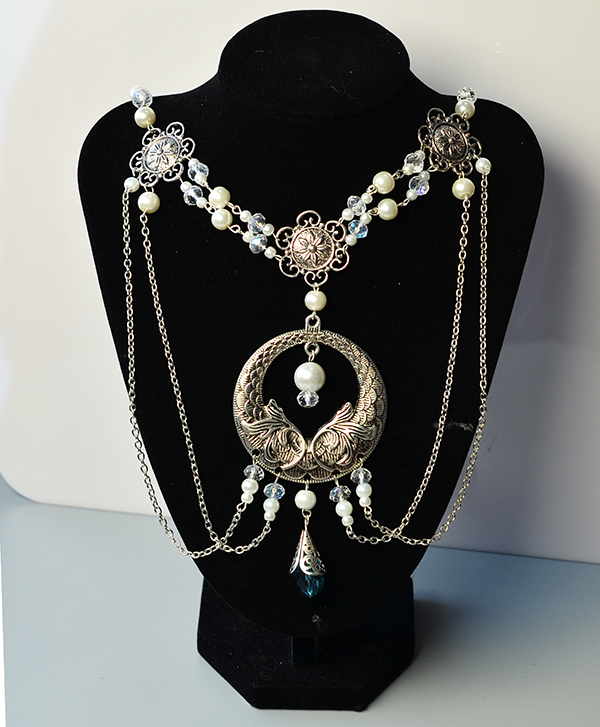 Here is the final look of the Tibetan style flower pearl hair jewelry: