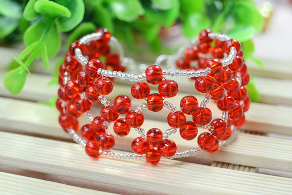 The final look of red embellished right angle weave bracelet