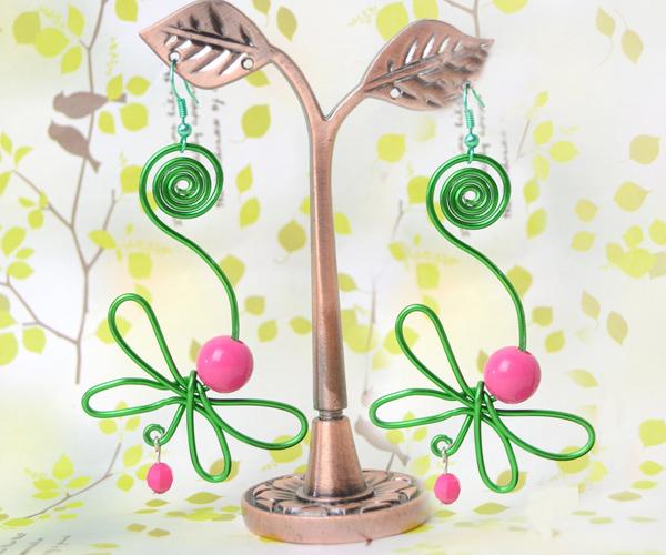The final look of lifelike green dragonfly earrings