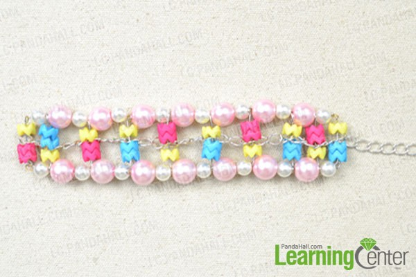 attach the middle layer to outsides of the wide beaded bracelets