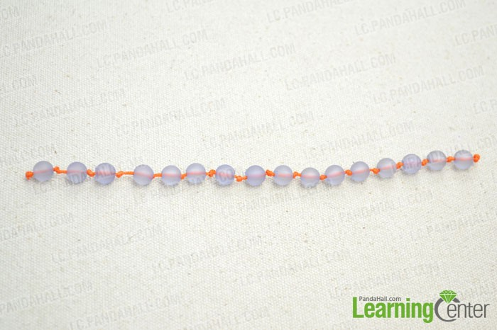 Make a knotted bead strand