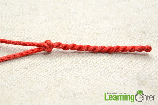 Secure the twist by tying a snake knot