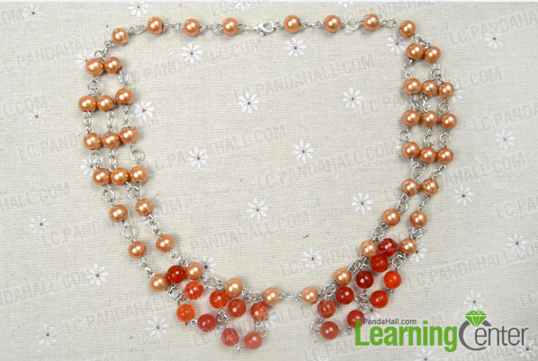 Attach agate bead links to the pearl necklace