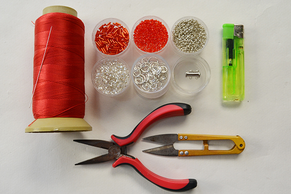 Supplies in making the red tube bead and seed bead bracelet: