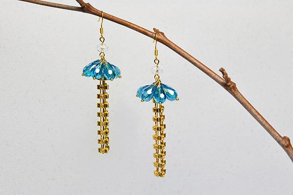 blue glass bead and golden chain tassel drop earrings