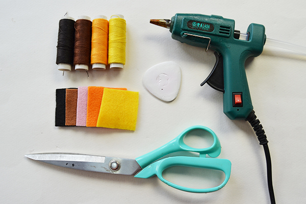 supplies needed in making the yellow homemade felt toy gloves