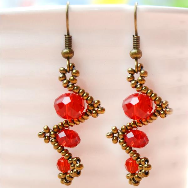 The final look of red beaded earrings