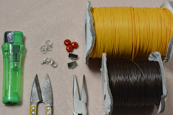 Supplies in making the waxed cord braided bracelet with acrylic beads decorated: