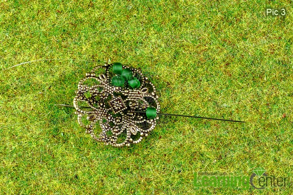 sewing green beads on metal findings