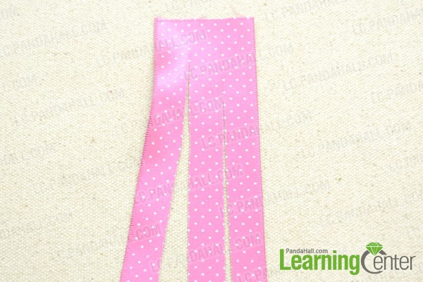 Divide the ribbon into three equal strips
