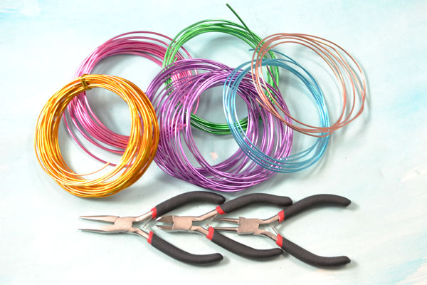 Materials and tools needed in making the colorful wire wrapped statement necklace: