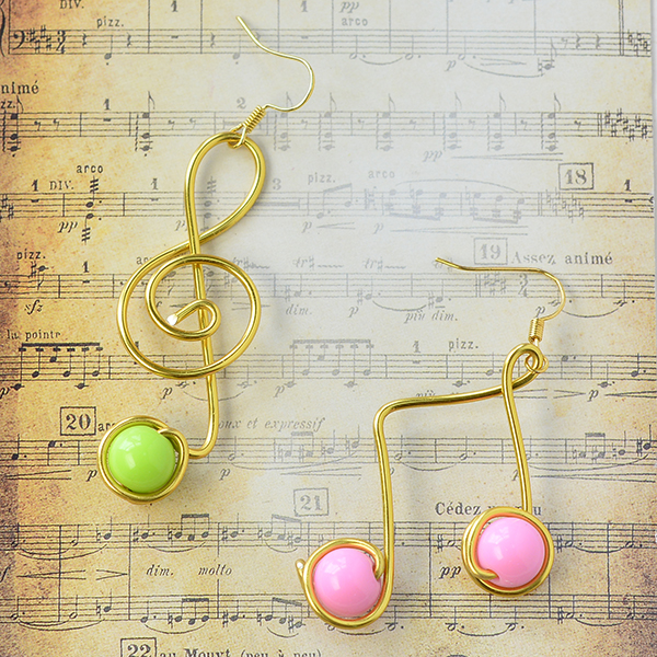 Instructions on making the stylish wire wrapped music note earrings with acrylic beads: