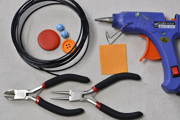 supplies needed in DIY the orange colored spider for Halloween