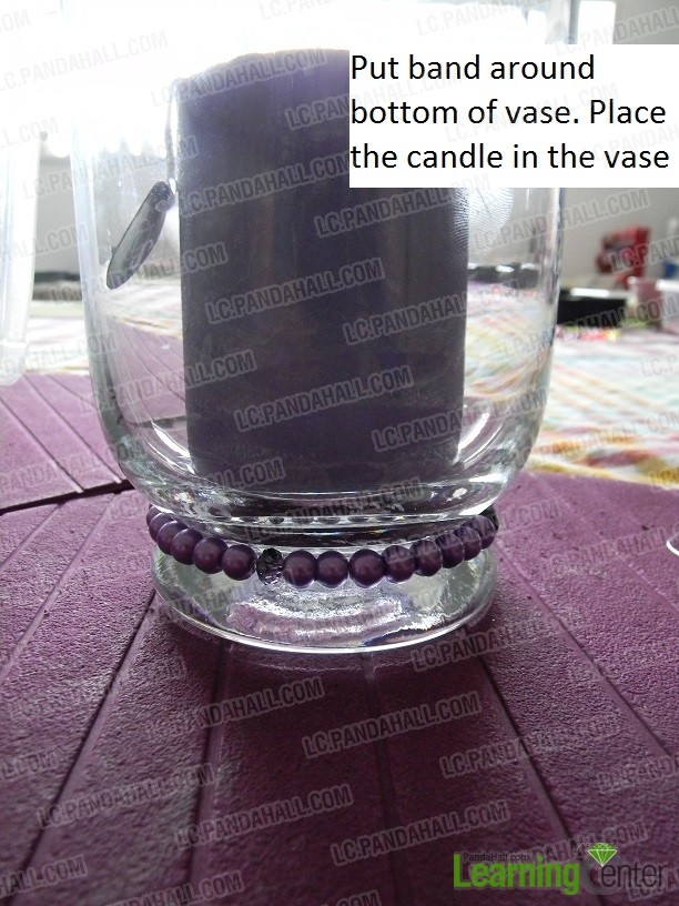 put beaded cord around bottom vase and place candle in it