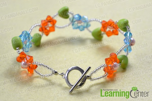 Finish making glass bead flower bracelets
