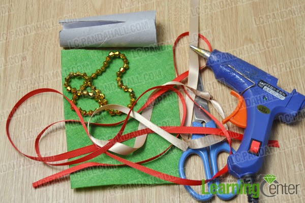 materials and tools for making a red and green Christmas tree
